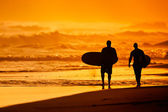 Sunset Surfers — Stock Photo