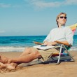 Young Attractive Man Relaxing at the Beach with Laptop Computer — Stock Photo