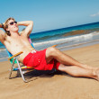 Portrait of calm young man relaxing on the beach — Stock Photo #9758185