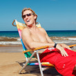 Business man at the beach - Stock Photo