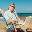 Royalty-Free Stock Photo: Business man at the beach
