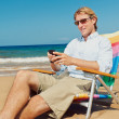 Business man calling by cell phone on the beach in Hawaii — Stock Photo