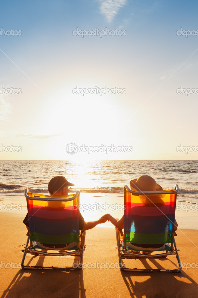 Happy Romantic Couple Enjoying Beautiful Sunset at the Beach  Stock Photo #9757948
