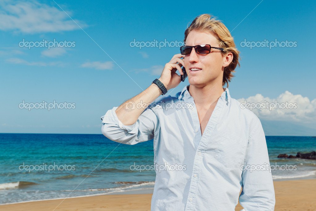 Business man calling by cell phone on the beach — Stock Photo #9758030