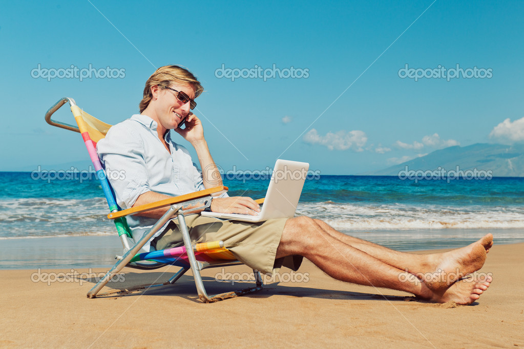 Business man calling by cell phone and working on computer at the beach in Hawaii  Stock Photo #9758266