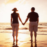 Senior Couple Enjoying Sunset at the Beach — Stock Photo
