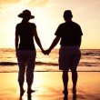 Stock Photo: Senior Couple Enjoying Sunset at the Beach
