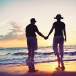 Senior Couple Enjoying Sunset at the Beach — Stock Photo #9838614