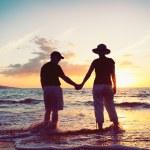 Senior Couple Enjoying Sunset at the Beach — Stock Photo #9838615