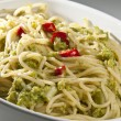 Italian dish of spaghetti with broccoli and hot pepper — Stock Photo
