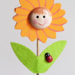 Ornamental wood stick with sunflower and ladybug — Stock Photo