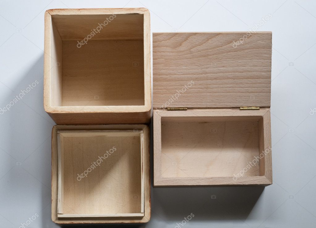 Two empty open wooden boxes on white background — Stock Photo #8504510