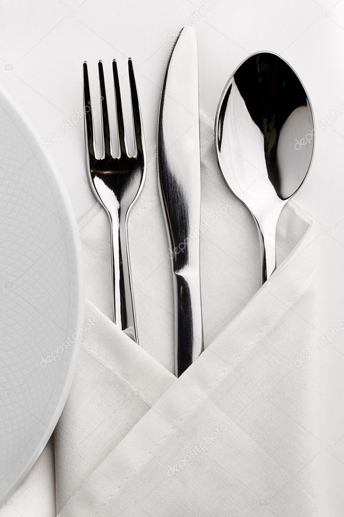 Table which served tableware wrapped in a napkin  Stock Photo #10125545
