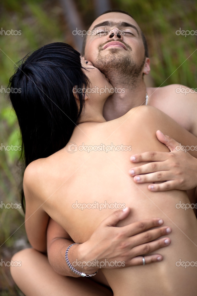 Girl tenderly kisses the guy in the neck — Stock Photo #10209921