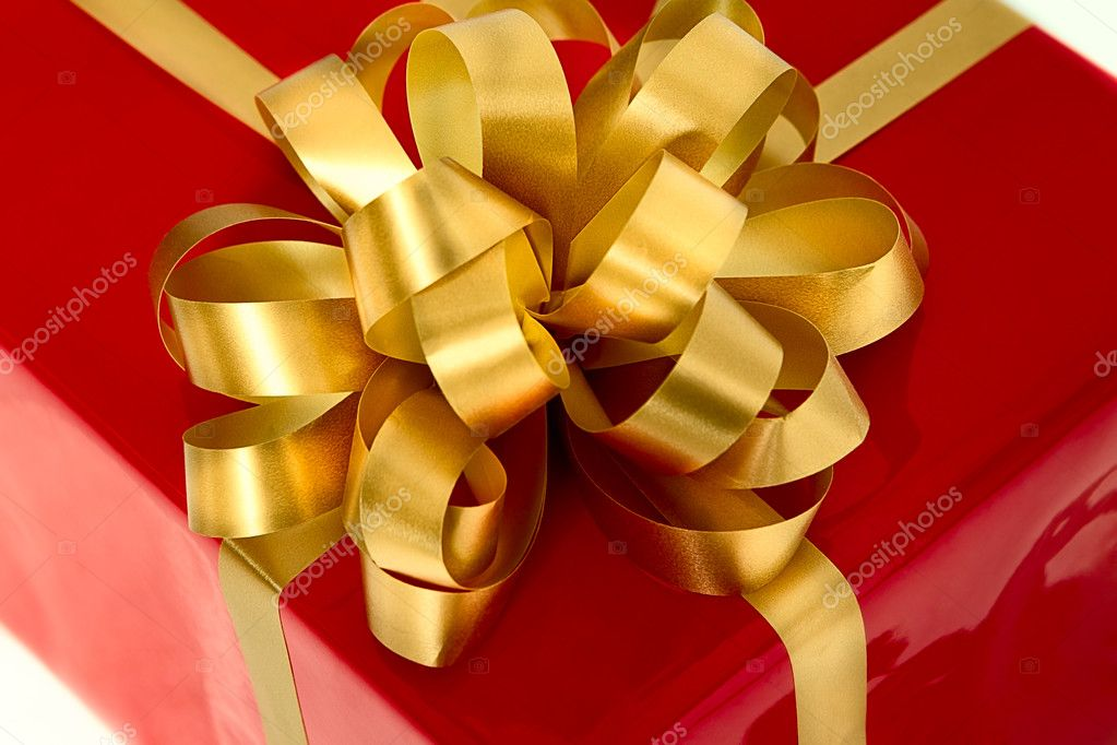Red gift box with gold bow  Stock Photo #10477290