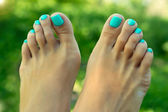 Feet with pedicure — Stock Photo
