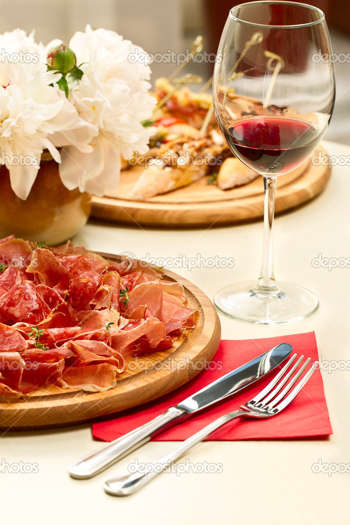 Spanish cuisine on the table and a glass of wine — Stock Photo #10722594