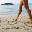 womans legs on beach — Stock Photo