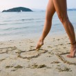 Womans legs on beach - Stock Photo