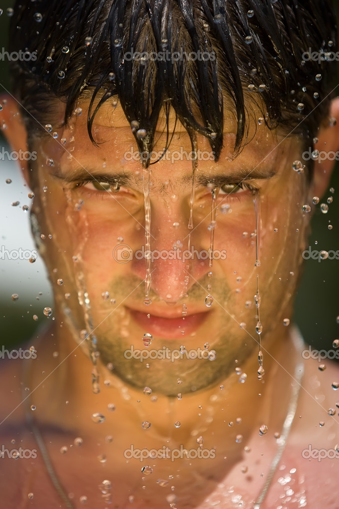 A splash of water in mans face,  closeup — Stock Photo #8530590