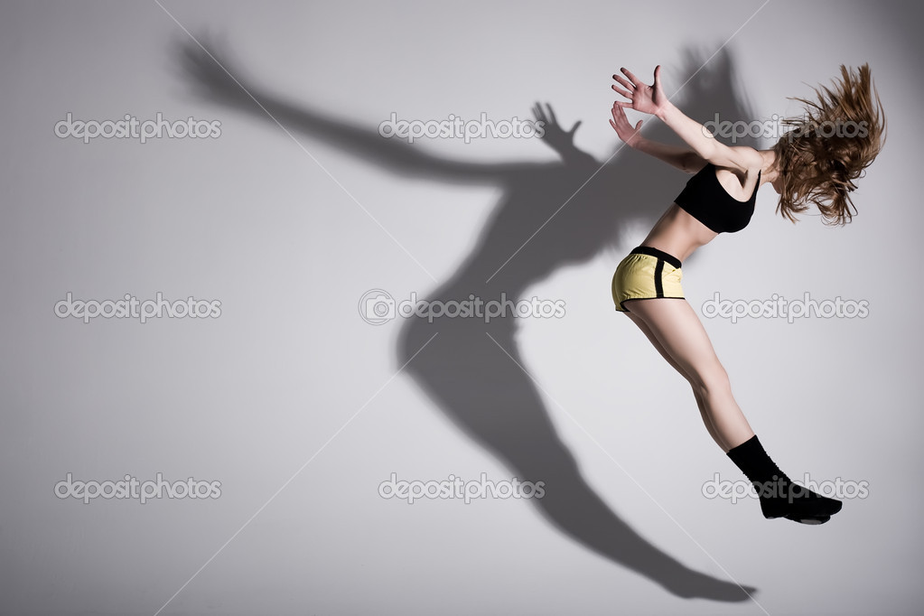 Dirl is jumping up with her shadow — Stock Photo #8578427