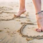 Womans legs on beach — Stock Photo