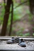Abandoned pair of children's sandals — Stock Photo