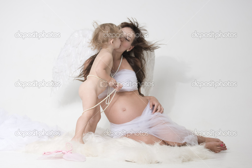 Angel mather with wings  is kissing her daughter  Stock Photo #8580970