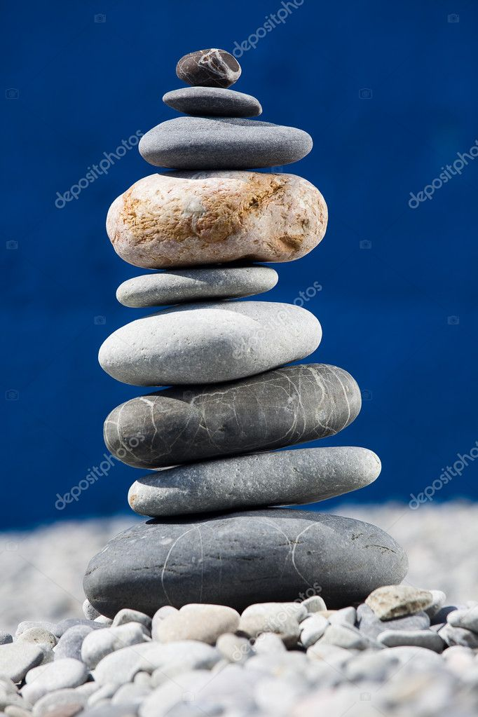 A pile of rocks stacked on the beach — Stock Photo #8584119