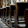 Benches in the cathedral - Stock Photo
