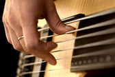 Hands on guitar — Stock Photo