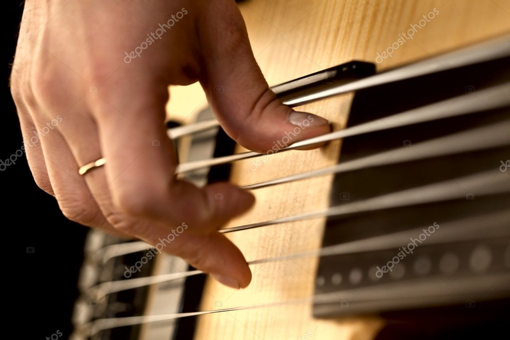 Fingers on the strings of the guitar — Stock Photo #8772093