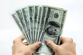 Dollars in hand — Stock Photo