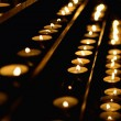 Candles in Cathedral - Stock Photo