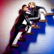 Latex girl and boy - Stockfoto