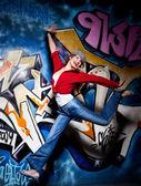 Girl and graffiti — Stock Photo