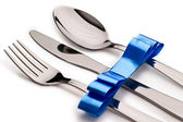 Cutlery with ribbon — Stock Photo