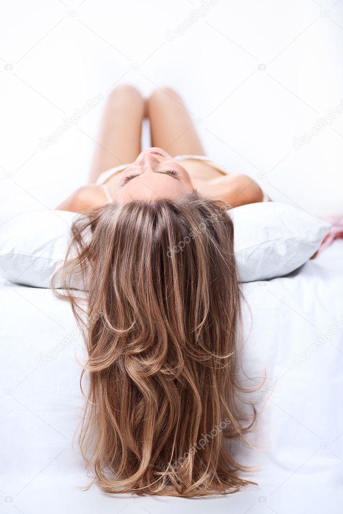 Beautiful long hair of young lady — Stock Photo #9875068