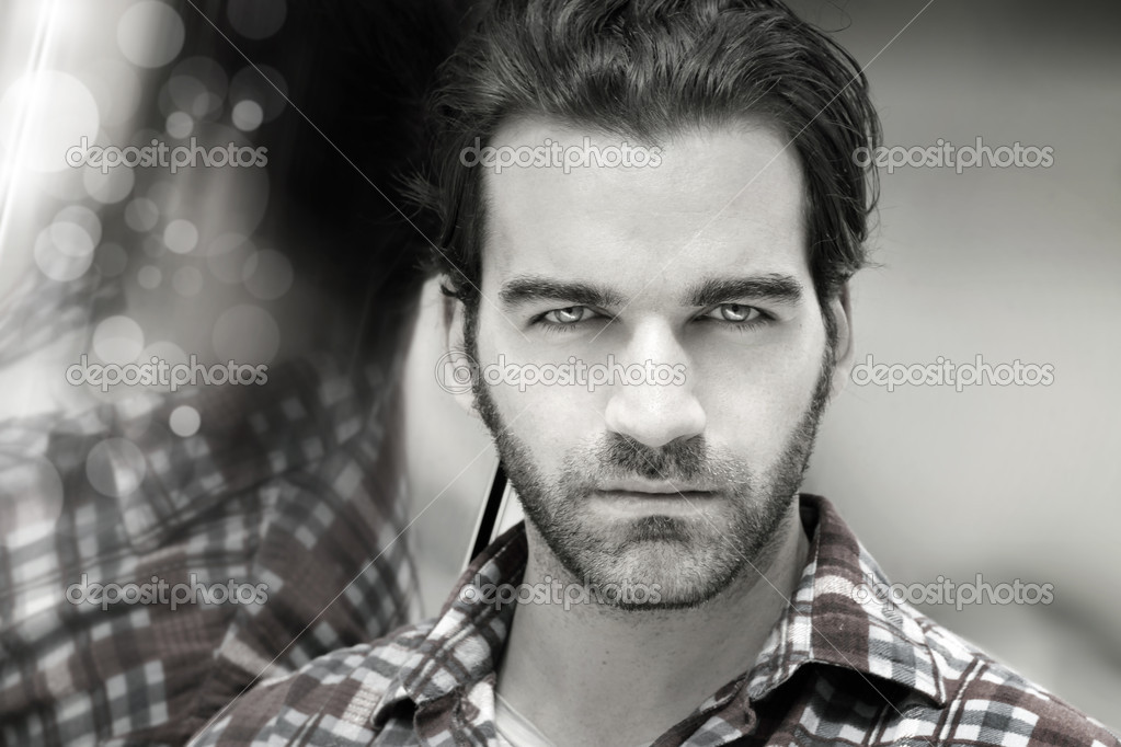 Closeup desaturated styled portrait of a masculine good-looking man — Stock Photo #10350788
