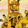 Old golden statue of Shiva in the East - Stock Photo