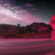 Photo of desert in pink light with speed limit street sign — Stock Photo