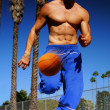 Athlete dribbling basketball - Stock Photo