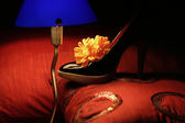 Still life of shoe and lamp — Stock Photo