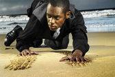 Young amn on beach crawling — Stock Photo