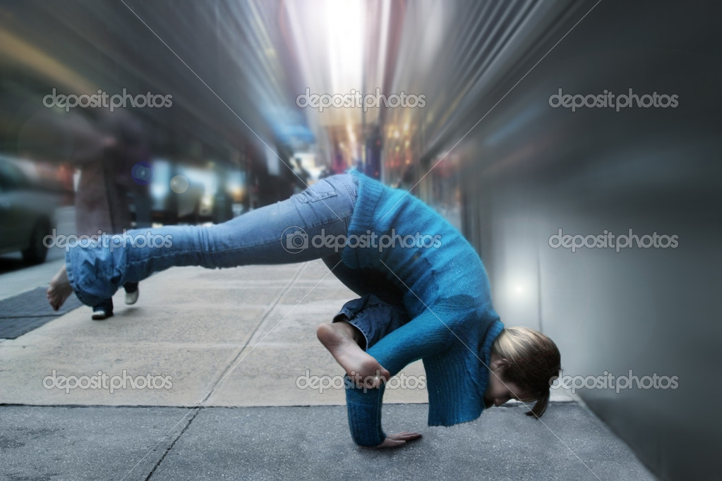 Woman in yoga position on the street  Stock Photo #8449031