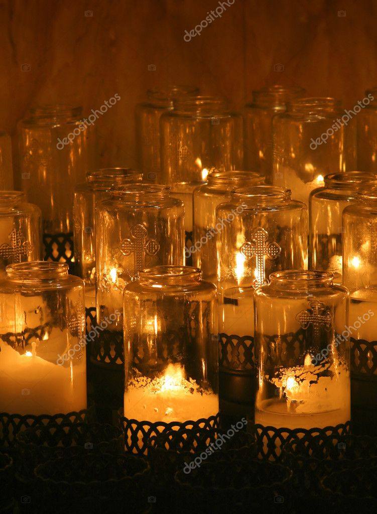 Group of lit candles in church chapel — Stok fotoğraf #8449196