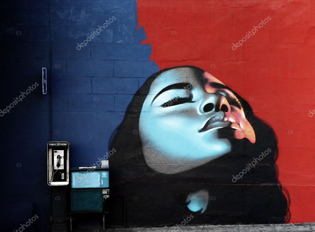 Woman's face painted on wall with vibrant colors — Stock Photo #8449197