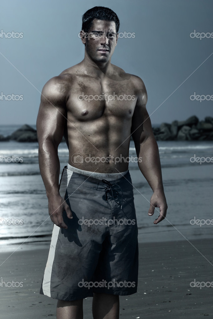 Young man on the beach with swim trunks — Stock Photo #8449207
