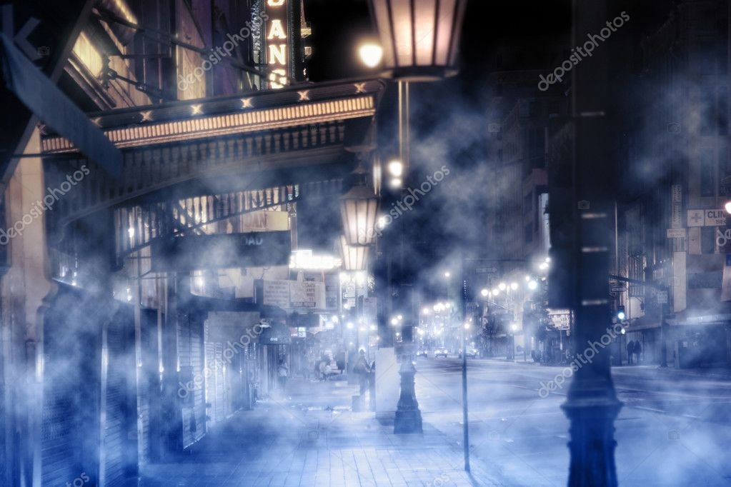 Foggy street scene with lights and peolpe at night — Stock Photo #8449334
