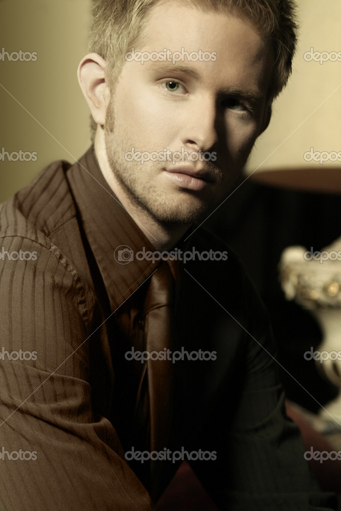 Elegant young man in suit and tie staring — Stock Photo #8449353